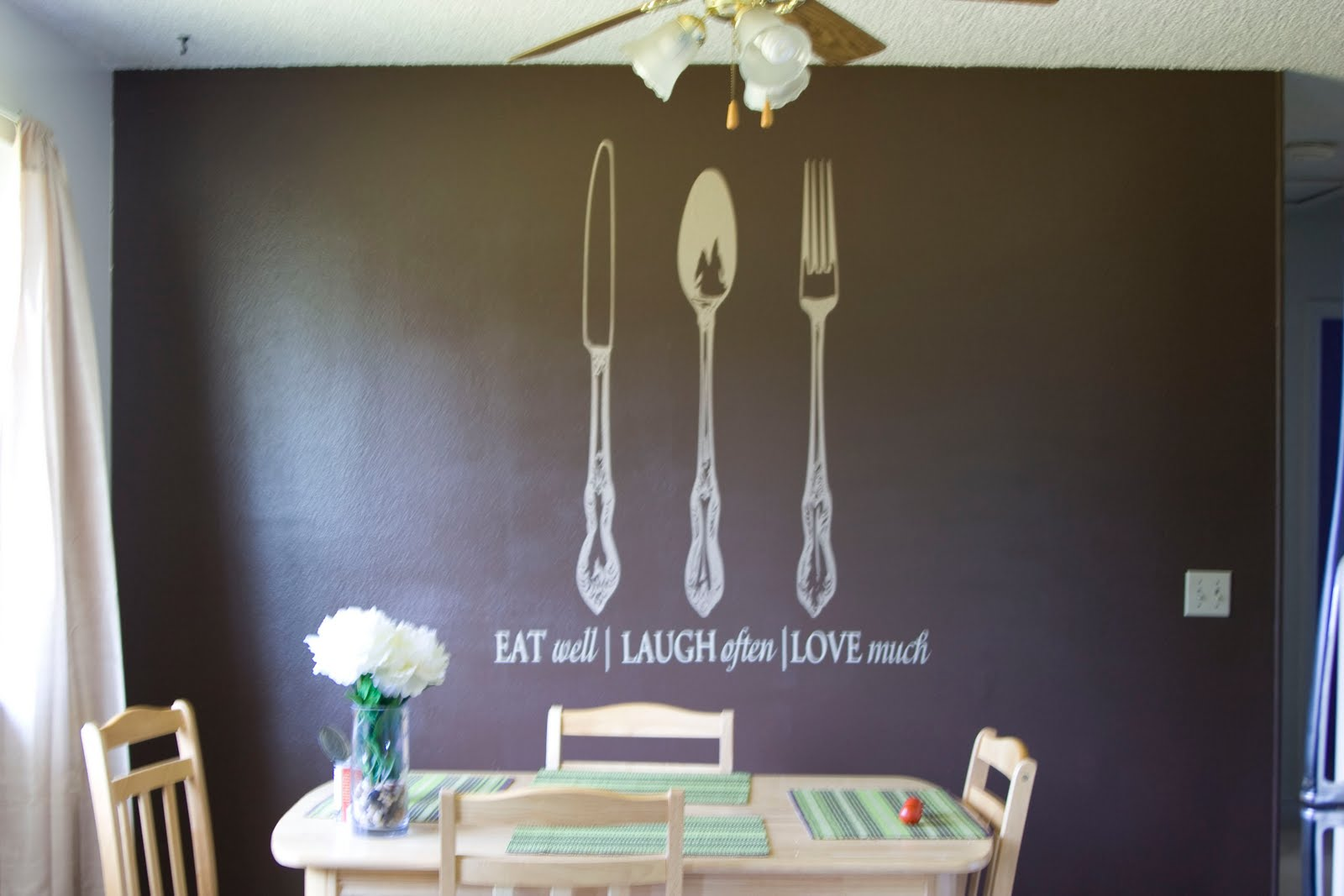 In the kitchen I painted an accent wall chocolate brown, and had large  title=