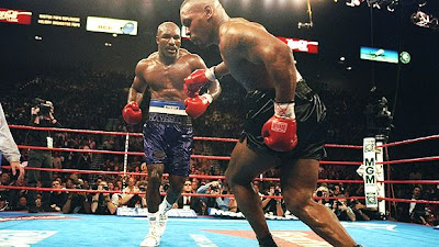 Evander Holyfield and Mike Tyson boxing