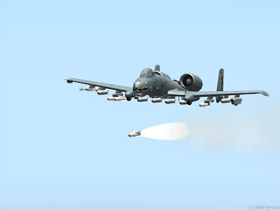 A heavily armed US A-10 Warthog firing an air to ground missile