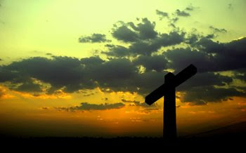 A silhouetted cross at sunset