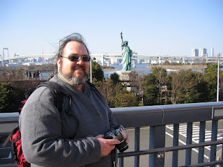 Jonathan Eller in front of Tokyo's Statue Of Liberty