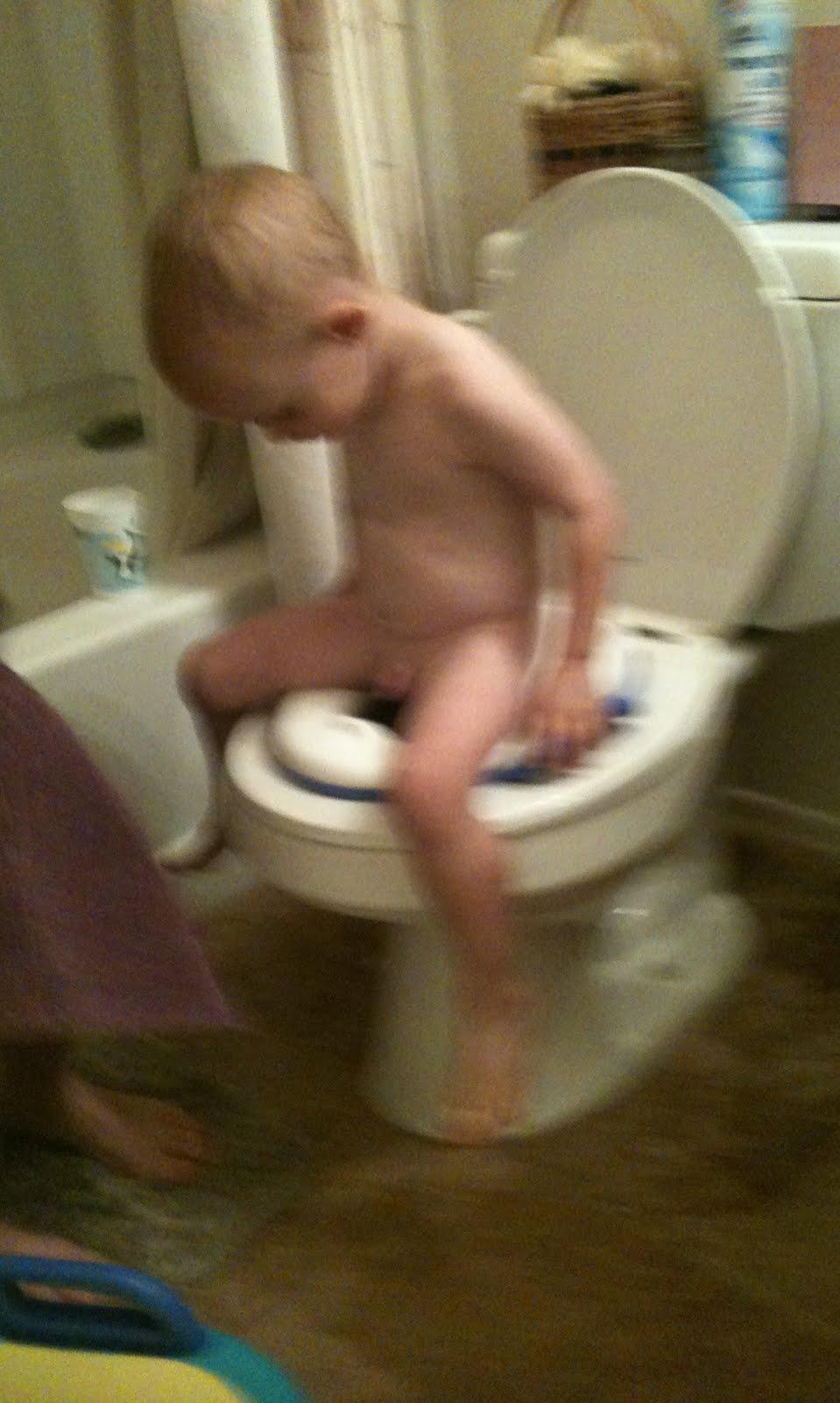 Boy potty training naked