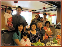 Snapshot of our beloved family, plus my sis, inside Benteng Coffee House, Quality Hotel