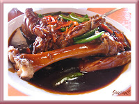 A plate of braised pork in thick soya sauce