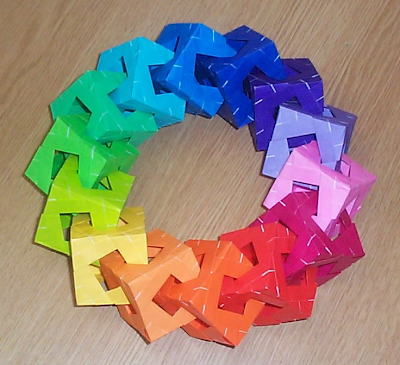 Fourteen cubes in a ring, from MODULAR ORIGAMI POLYHEDRA by Simon, Arnstein and Gurkewitz