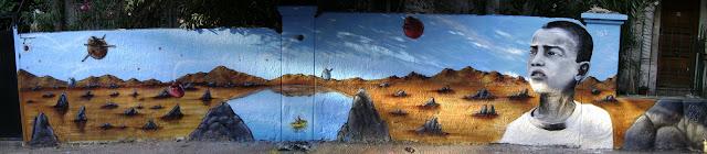 graffiti de izak y sick en bellavista, santiago, chile