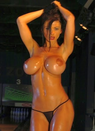 Sexy woman with oiled XXL