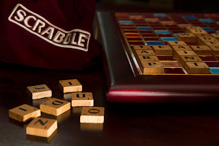 Scrabble board lit with a single light from three angles