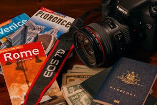 Camera, Passport, Maps and cash.... the travel essentials