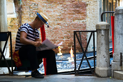 A Gondolier waiting for a hire - Venice, Italy