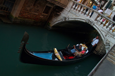 Tourists on one of the Venetian Canals - Venice, Italy