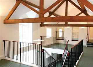 Award winning barn conversions The dark interior of the barn, before the builders arrive