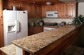 Kitchen Granite Countertops With glistening solid granite countertops and wonderful wood flooring