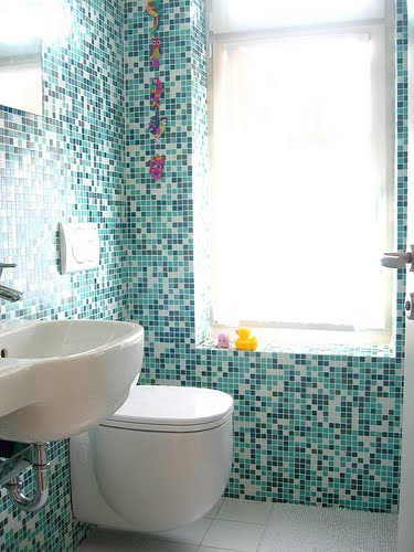 Small Bathroom Tiles Tile work gives this bathroom an ultra-modern look