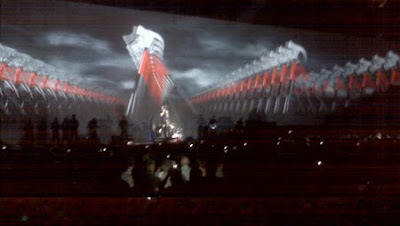 Shot from the show with hammer projections on screen