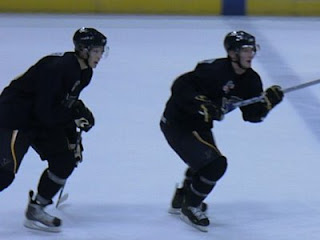 Lars Eller (L) and Simon Hjalmarsson skate up ice at the Blues' 2008 Development Camp (St. Louis Game Time photo by Brian Weidler)