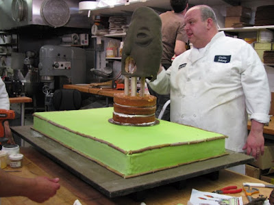 Cake Boss Tiki cake a blindfold a bikini and breathing fire Mauro Castano screencaps images bakery photos pictures screengrabs Libby Klein