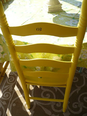 painted chairs on porch