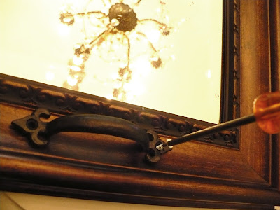 attaching handles to a mirror to make it a tray