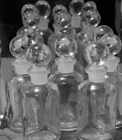 Photograph of several small apothecary bottles.