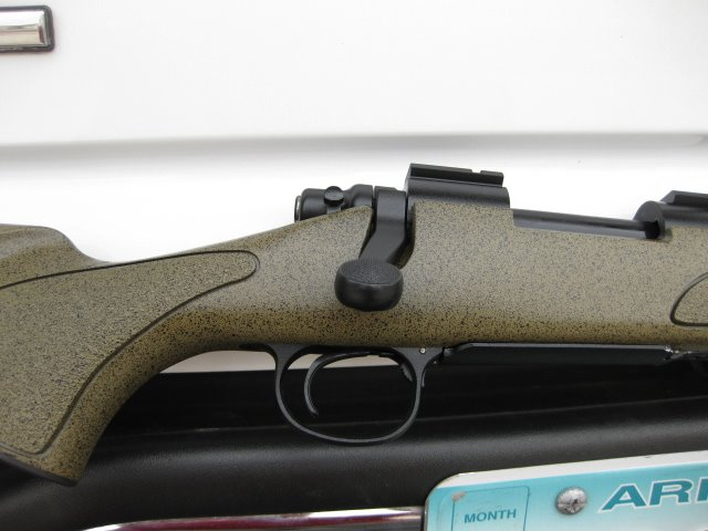 Winchester black plastic stock, spattered to match New Mcmillan stock colors