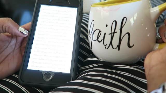 Image: Woman On Iphone and holding Faith Coffee Cup