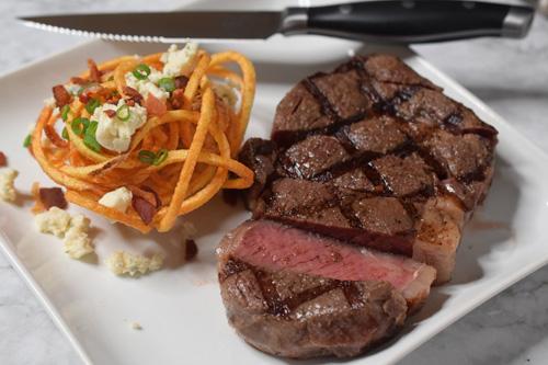 Dry-aged ribeye steak with crisp potato stack