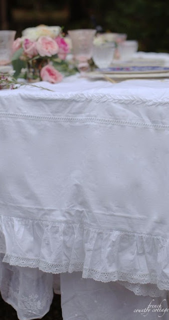 White duvet and bedskirt used as a tablecloth