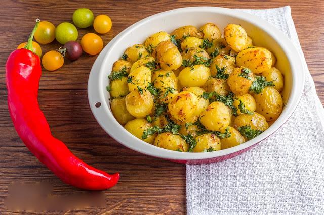 طريقة عمل صينية البطاطس بالأعشاب