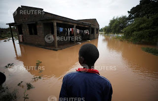 Agiro Cavanda looks at his flooded home in the aftermath of Cyclone Kenneth, at Wimbe village in Pemba, Mozambique, April 29, 2019. (Credit: Reuters/Mike Hutchings) Click to Enlarge.