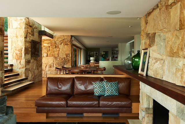 Stone walls and leather sofa in the living room