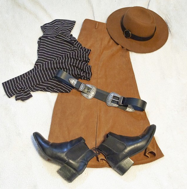A flatlay of a brown panama hat, a black and white striped turtleneck, a black two buckle western belt and black chelsea boots.