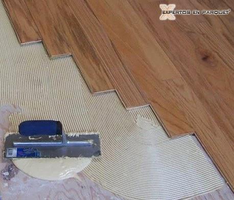 Tipos de adhesivos principales para el encolado de suelos for Parquet madera maciza