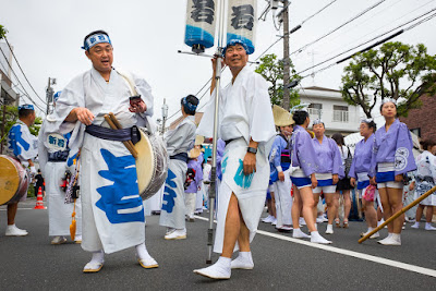 Standard bearers at the 60th Koenji Awa-Odori Parade, Tokyo, 2016 waiting for 5pm start time to come around.