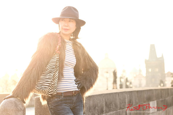Fashion and Lifestyle on the Charles Bridge, model, early morning. Photography by Kent Johnson.