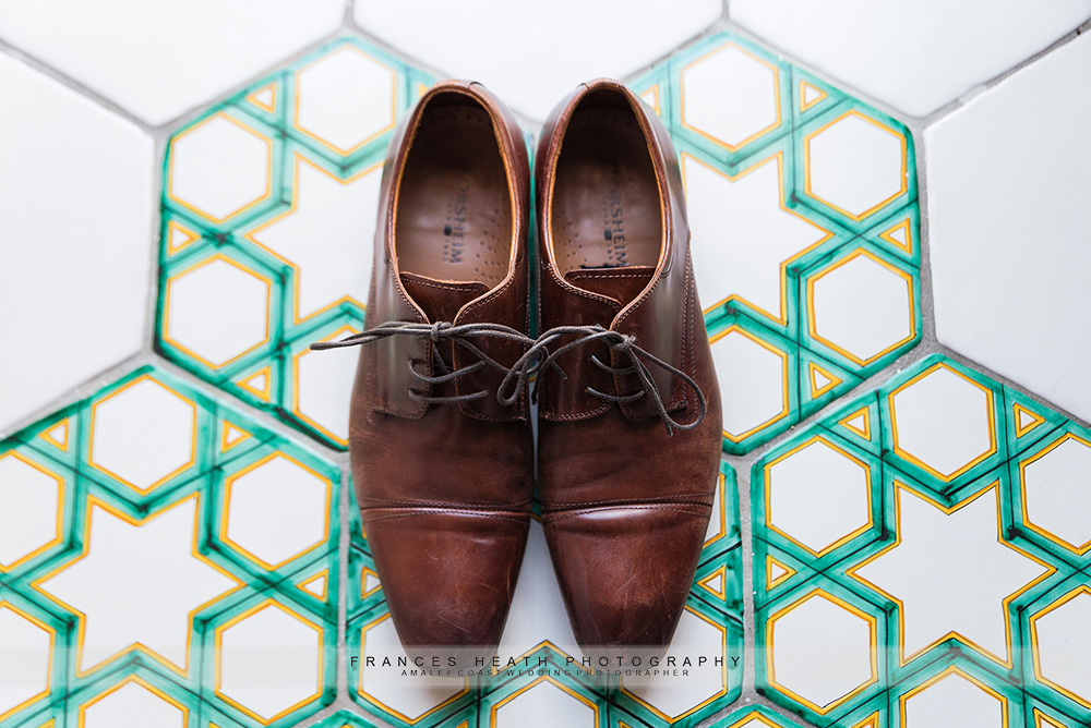 Groom's shoes on Amalfi coast ceramic tiles
