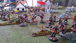 A photo of my Word Bearers cultists facing the imperial fists in a game of warhammer 40000