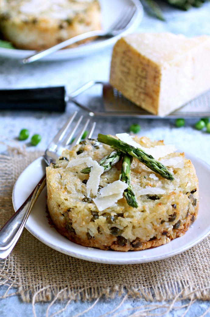 Recipe for a baked rice dish flavored with Parmesan cheese, fresh asparagus and peas.
