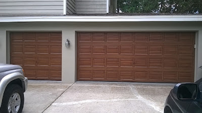 two garage doors painted to look like wood