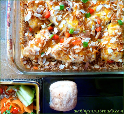 Chicken with Rice Dinner Casserole. Boneless chicken breasts, vegetables and rice cook in the oven in a flavorful broth | Recipe developed by www.BakingInATornado.com | #recipe #dinner #chicken