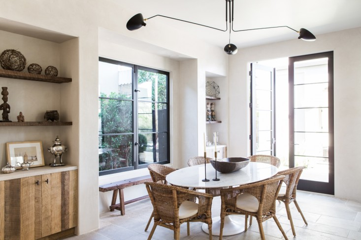 Beautiful dining area in kitchen of villa with European inspired interiors by Leigh Herzig - seen on Hello Lovely