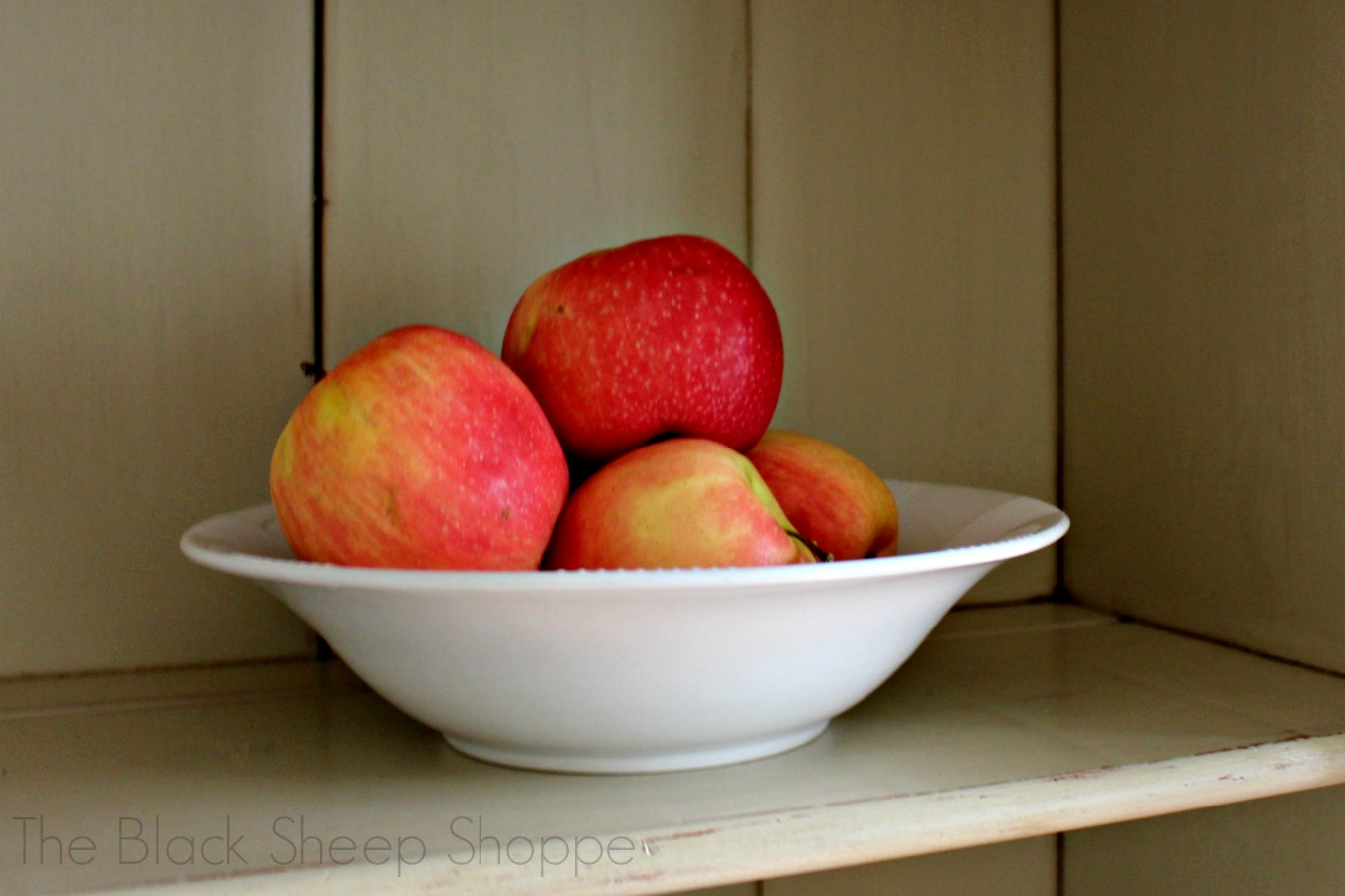 Red apples in white bowl against Country Grey background