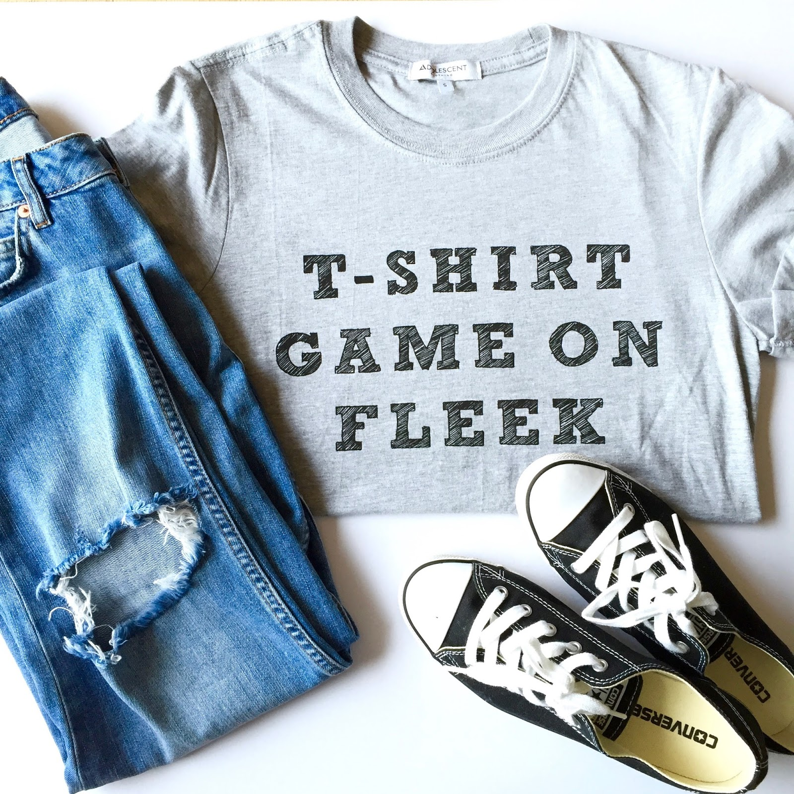 slogan tee with ripped jeans