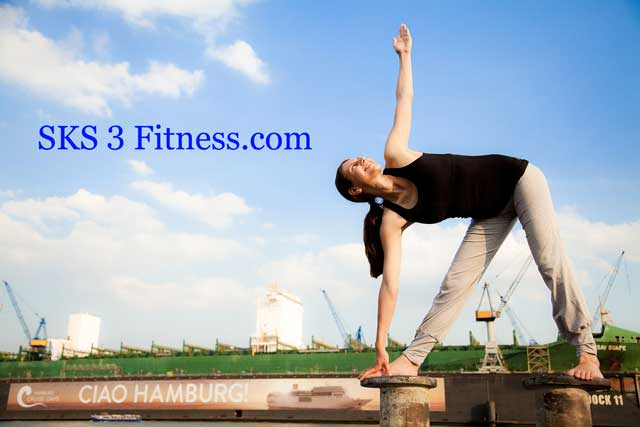 A women doing Trikonasana near dock