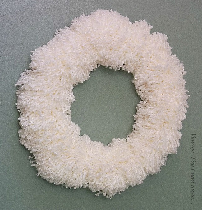 Vintage, Paint and more... a diy yarn wreath made by tying yarn pom poms on a wire wreath form