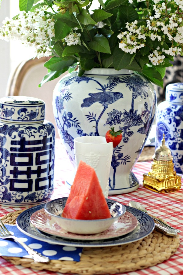 red white and blue tablescape, fourth of july decorations, patriotic table setting, blue and white ginger jar, milkglass