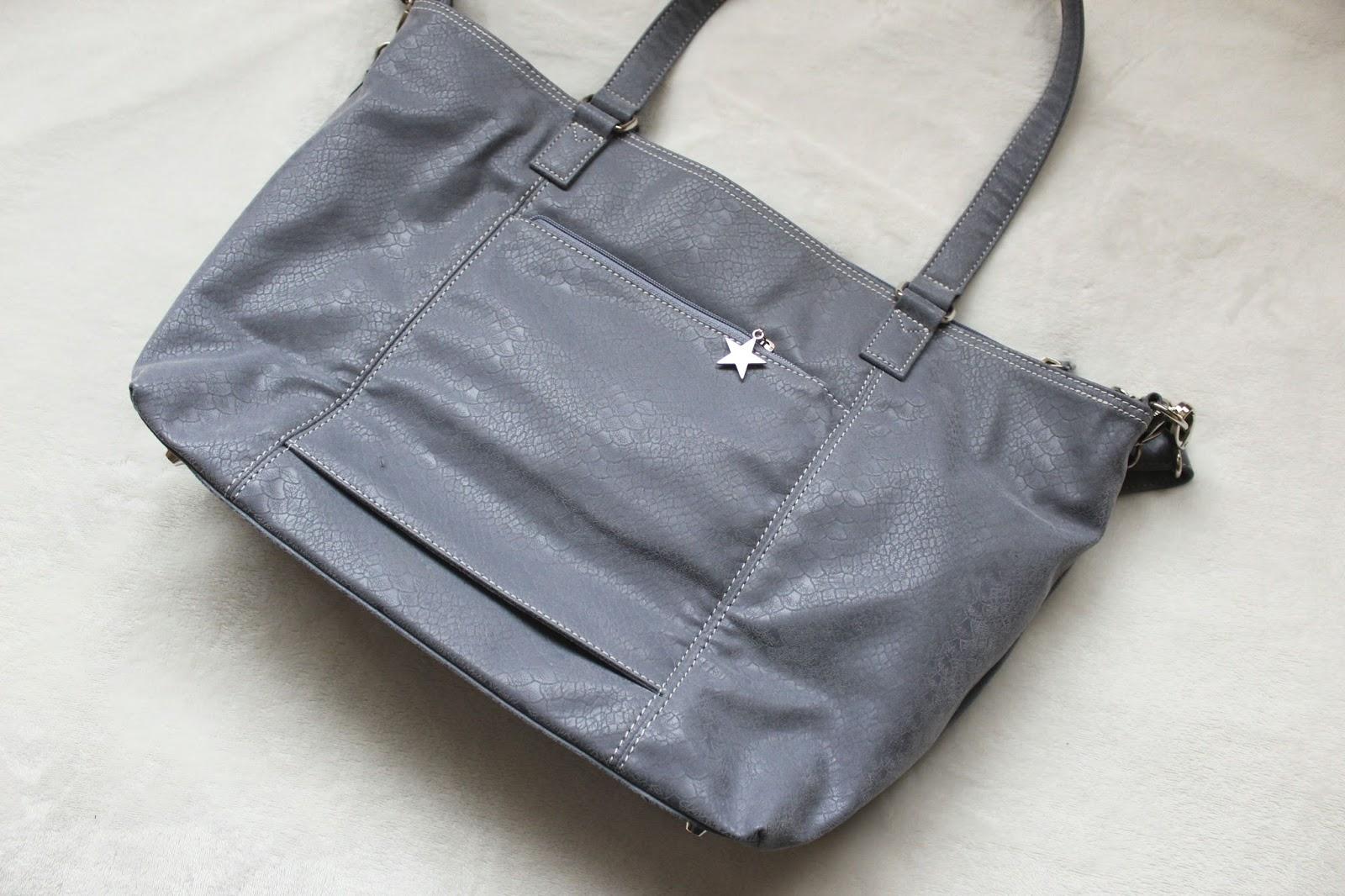 Large grey handbag on white background