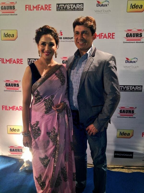 Madhuri Dixit and Sriram Nene arrive at the Filmfare Awards party. She looks stunning