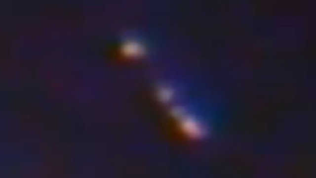 This is a closer look at the ISS UFO which lingers and reverses away from the ISS.