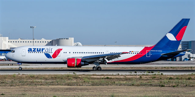 Boeing 767-300 of Azur Air While Taxiing Runway Red Blue White Livery